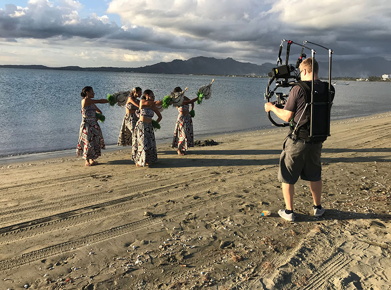 The film crew sets up a shot featuring Fijian dancers.