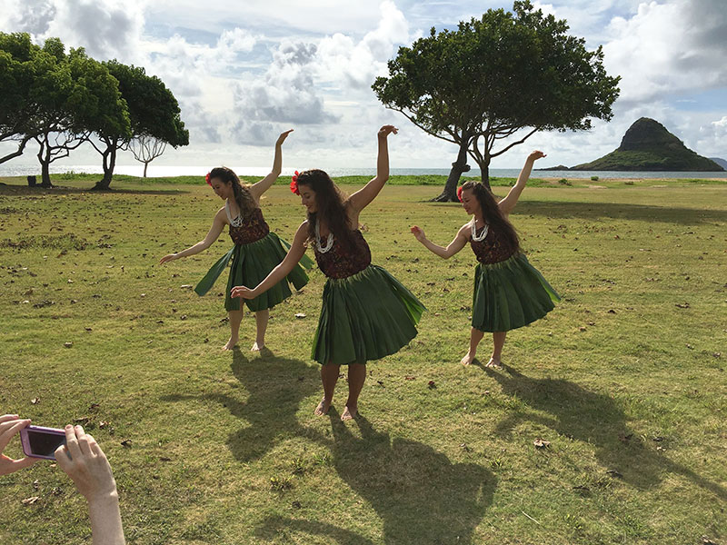 Hawaiian dancers perform on location.
