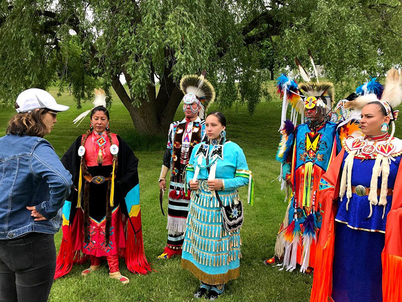 Native American dancers prepare to perform for the film Dancing Joy.